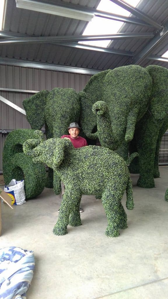 Artificial topiary Elephants and Creator Steve Manning