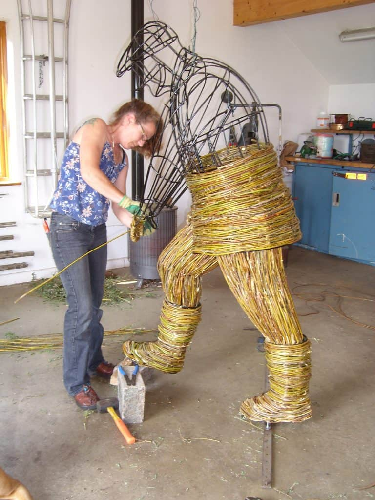 Making willow wicker woven Gardener figure with spade