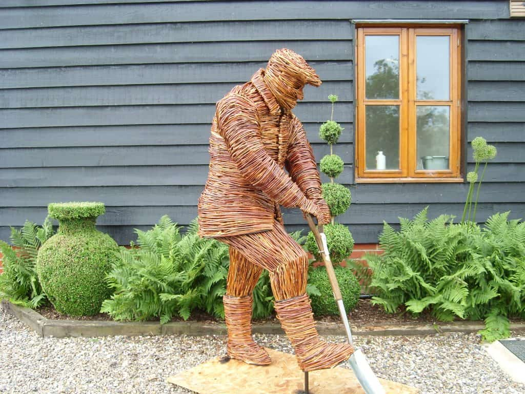Making willow wicker woven Gardener figure with spade Thetford Garden centre