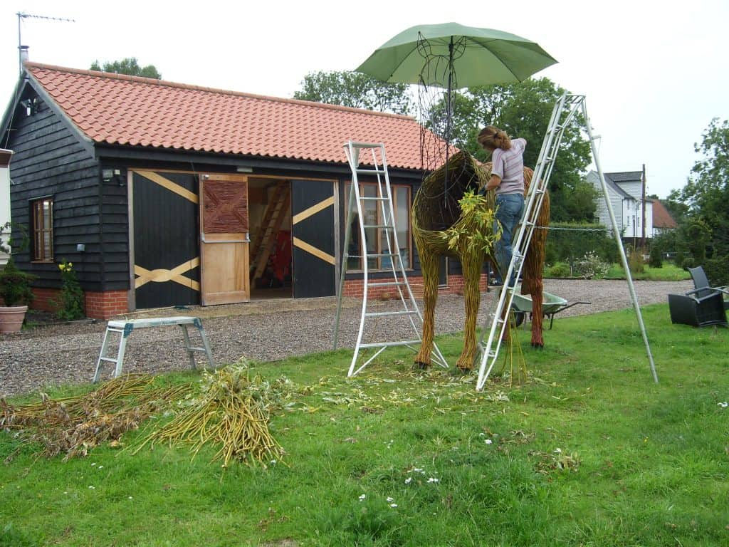 Making willow wicker woven Horse