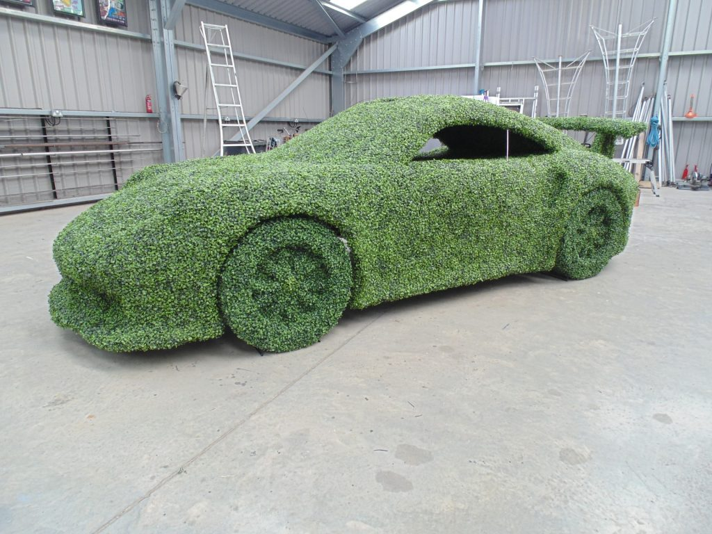Topiary Porsche 911 GT3 RS car in artificial boxwood hedge